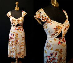 1940's cowboy novelty print rayon dress with peekaboo bodice.