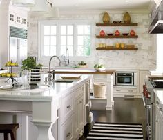 40 Ideas Of Using Open Shelves On A Kitchen | Shelterness Multiple islands and a black and white striped rug.