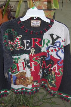 Today's winning sweater:   Vintage 80s Heirloom Collectibles Tacky Ugly Oversize Cropped Holiday Christmas Xmas Sweater Small. $24.00, via Etsy.