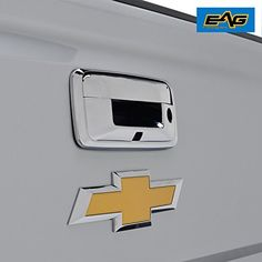 E-Autogrilles Triple Chrome ABS Tailgate Door Cover With Camere Hole for 14-17 Chevy Silverado 1500 / GMC Sierra 1500 / 15-17 Silverado 2500/3500 / Sierra 2500/3500 / Canyon / Colorado  FITMENT -14-17 Chevrolet Silverado 1500/14-17 GMC Sierra 1500/15-17 Chevrolet Silverado 2500/3500/15-17 GMC Sierra 2500/3500/15-17 GMC Canyon/15-17 Chevrolet Colorado.  FINISH -Triple Chrome Plated ABS finish enhances the look of your vehicles trim for a true custom look.  DURABLE MATERIAL -Made of auto...
