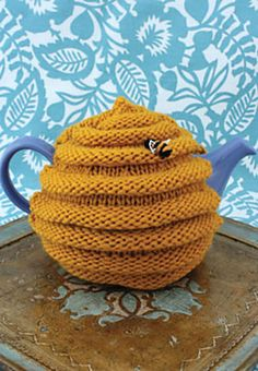 Easy-to-remember switches between knit and purl rows make this pattern simple to follow and rewarding to finish. Create a textured beehive and decorate it with little bee appliqués when you're done! (Patons Yarns)