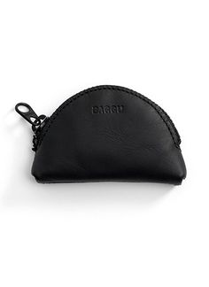 Black leather coin pouch, a great place to stow your earbuds. By Baggu.