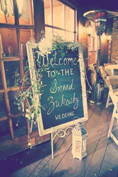 A chalkboard draped delicately in flowers is a great way to welcome guests