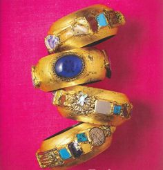 """The tones of gray, pale turquoise and pink will prevail."" Christian Dior....Looks like gold leaf on wooden bangles with precious stones and baubles glued on."