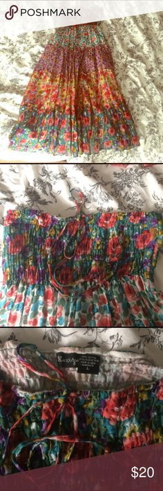 Maxi skirt or strapless midi dress Worn once.  Can either be a maxi skirt or a strapless midi dress.  The top is adjustable with string tie closure.  I would say it runs small.  So pretty.  Jean jacket not included Skirts Maxi