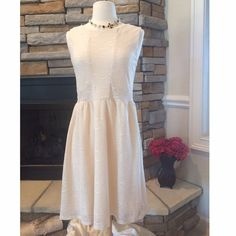 Ivory Lace Dress In new condition. No flaws. Beautiful ivory lace. Questions? Please ask- fits true to size Dresses Midi