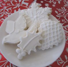 Love the idea of all white Christmas cookies! Can wrap each individually in cellophane for wedding favors? Or if not, just a plate of cookies on cake table?