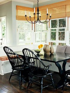 Create a cozy u-shaped banquette to maximize seating and table space.