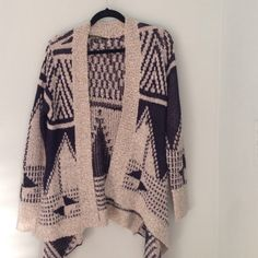 """Geometric print knit sweater by Love Stitch Heavy knit sweater in tan with navy blue geometric prints. Back of sweater ends at top of butt and sides taper about 4"""" above knee. Super cute for those cool summer/spring nights thrown over a tank top with a pair of high waisted shorts or jeans! Love Stitch Sweaters Cardigans"""