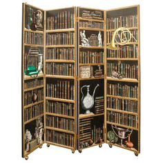 Piero Fornasetti Screen  Italy  Original Design in 1950s  Four Panel Fornasetti Library Screen on Wheels.