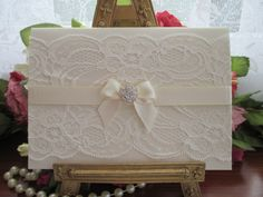 K0011 Ivory Lace Satin Bow Diamante Wedding Invitation www.vintagelaceweddingcards.co.uk