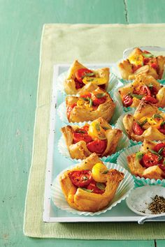 Muffin Pan Tomato Tarts - Festive, No-Fuss of July Appetizers - Southernliving. Recipe: Muffin Pan Tomato Tarts These tasty little bites made with puff pastry and colorful cherry tomatoes will be the hit of any summer party. Puff Pastry Appetizers, Easter Appetizers, Easy Appetizer Recipes, Puff Pastries, Appetizer Ideas, Hot Appetizers, Dinner Recipes, Beats By, Tomato Tart Recipe
