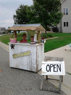 """Had this made fr om old barnwood. On wheels. Check out the old cabinet door """"Open"""" sign!"""