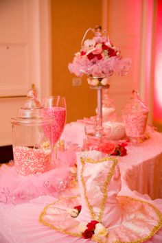 Ballerina party table decor with pink candy.