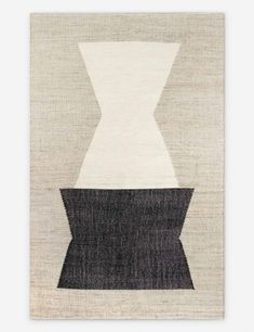 A modern rug with a bold geometric design adds a sculptural look to your living room or dining room. This handmade flatweave area rug features neutral tones for versatile styling, and yarns blended with natural fibers for a texture-rich feel.