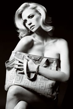January Jones strips down for Versace's spring 2011 accessories campaign shot by Mario Testino. Wearing nothing more than the label's oversize bags and sle