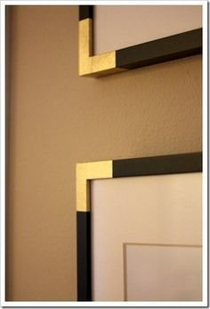spruce up a black frame with gold paint on the corners