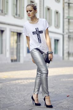 metallic silver pants with graphic top and box clutch