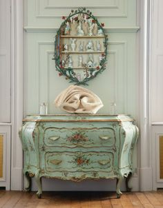 Crisp yet calming seafoam green colored decor inlcluding a gorgeous commode decorated with flowers #chinoiserie #monochromatic #LesTroisGarcons