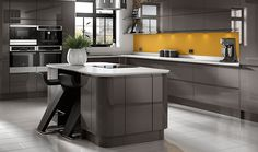 This Wickes Sofia Graphite kitchen's high gloss, dark grey units create an unusual and striking contemporary look.
