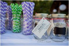"""Favors AND drinking glasses.  Mason jars with """"chalkboard"""" labels and white paint pens are a perfect touch!"""