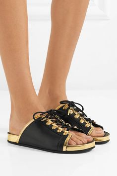 Sole measures approximately 15mm/ 0.5 inches Black and gold leather  Slip on Imported