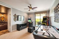 Consoles, Arcade Cabinets, and Air Hockey, all off a nice big bright door to the balcony.