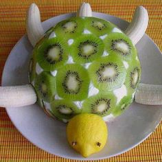 Food Art: http://myhoneysplace.com/food-art-pictures/ Cheese ball covered with kiwi, 3/4 lemon with cloves for eyes. Bananas rinsed in lemon for legs, and tail