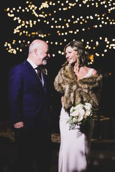 """So in love 😍 This picture is from the """"Romantic Christmas Eve Wedding"""" by Brantford Blooms Florist. Cranberry dresses, fur coats, chestnuts roasting by the fire, and a festive dinner. This dinner had everything you could ever dream of 😍 Christmas Wedding, Christmas Eve, Cranberry Dress, Blooms Florist, Roasted Chestnuts, Wedding Flowers, Wedding Dresses, Fur Coats, Our Wedding"""