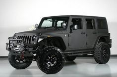 Wow 2014 Jeep Wrangler Unlimited with Black Satin Kevlar exterior, 4x4, and stick shift.... $49,885 from Starwood Motors