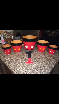 DIY Mickey Mouse Jars made out of planters for a candy Buffet table