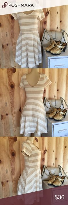 "/Romeo & Juliet Couture/ stretchy skater dress Romeo & Juliet couture Scoopneck fit & flare skater-style dress. Polyester, cotton, spandex blend- ivory fabric with metallic gold stripes. Size medium - thank you! Dress length from shoulder to hemline - 34.5"" Romeo & Juliet Couture Dresses Mini"