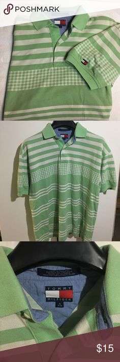 TOMMY HILFIGER Gingham Polo Shirt TOMMY HILFIGER Gingham Polo Shirt. EUC. Tommy Hilfiger appliqué on left sleeve. 100% Cotton. Smoke Free Home. Tommy Hilfiger Shirts Polos