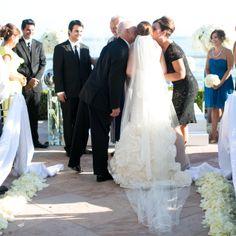 The bride's parents kiss her as she reaches the altar - See more at: http://magazine.fourseasons.com/weddings/real-weddings/santa-barbara-beach-wedding#sthash.rbrwtTbl.dpuf