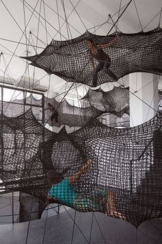 Visitors to an Innsbruck gallery can crawl from room to room via a series of bouncy net tunnels installed by design collective Numen/For Use.