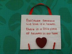 Put a picture of a loved who has passed on the pegs underneath, wooden plaque