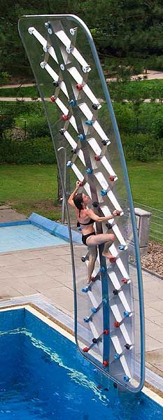 Over-the-pool rock wall-- looks like so much fun! K.. I want a pool just for this!!