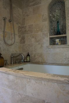 Tumbled Jerusalem limestone in this gorgeous shower. Pebbles in niche.