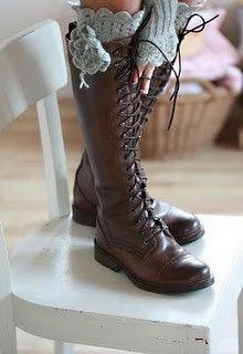 knit socks peeking over boot tops.