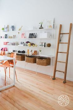 """The New Man Repeller Office - This ladder was moved from <a href=""""https://www.homepolish.com/mag/man-repeller-first-office"""" target=""""_blank"""">the first Man Repeller office</a>. Leandra's original thoughts on the seemingly superfluous tool: """"I'd seen an image of a white room with rustic wood floors and a ladder positioned somewhere that didn't lead anywhere. It made me laugh/feel comfortable so I wanted to approximate that vibe."""" - @Homepolish New York City"""