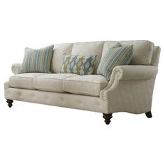 Nailhead-trimmed sofa with a tufted apron, two throw pillows and one kidney pillow. Made in the USA.