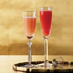 Blood Peach Bellini | The Blood Peach Bellini was originally made using super-seasonal summer blood peaches. This variation combines Campari, grenadine and white peach puree to approximate the rare fruit's flavor and color.