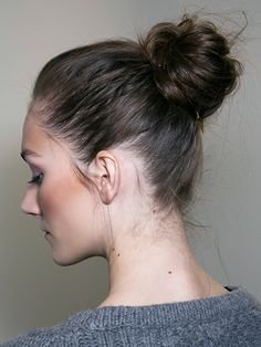 """Diane [Von Furstenberg] wanted a ballerina-inspired bun, but a ballerina in rehearsal,"" says Pita. He worked dry shampoo into the hair before tying it in a ponytail at the back of the head. He back-combed the tail with a teasing comb, then twisted it into a bun with bobby pins. He broke up the bun with his fingers to create the messy, imperfect finish."