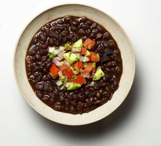 NYT Cooking: I love black beans, and this inky soup shows them off at their toothsome best. The soup gets a dramatic finish with a mound of tomato-avocado salsa. It is hearty enough to serve for lunch or a light dinner Pressure Cooker Black Beans, Stovetop Pressure Cooker, Pressure Cooker Recipes, Pressure Cooking, Easy Black Bean Soup, Avocado Soup, Weight Watchers Meals, Soups And Stews, Cooking Nytimes