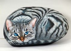 Cat painting on rock