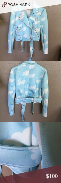 Sugar Pills Scuba Cloud Moto Jacket size S EUC Clod Moto Jacket by Sugar Pills. Baby Blue and white light weight Scuba fabric with gold Hardware. Two snaps at bottom flaps of Collar. Zips at pockets and sleeves as well as up the front. Belted waist. Size small. Great condition... sugar pills Jackets & Coats