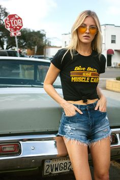 "Two of our favorite things... Dive Bars and Muscle Cars. Vintage inspired and printed on super soft black fitted tees. 1970's inspired graphic with vintage style distressing. We suggest sizing up if you prefer a looser fit or are in between sizes. - 100% Cotton - Women's fitted tee - Models are wearing size small - Ethically made, manufactured and printed in Los Angeles. Sweatshop free Measurements- taken flat (chest width) Small- 16"" (32"" doubled) Medium- 17"" (34"" doubled) Large- 18"" (36""…"