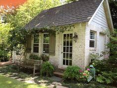 little garden cottage with vines, bench, trellis, nice landscaping
