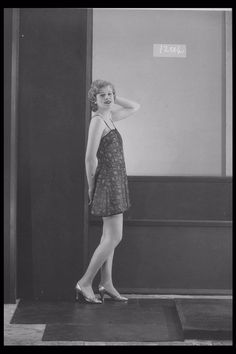 Glass Half Plate  Image of a woman modelling lingerie for the ladies' underwear manufacturer Byerleys Ltd.    Maker:  Bassano Studio  Production Date:  1933-11-16