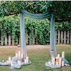 Love the fabric pooling on the ground with the candles. Such a nice display, perfect for a Wedding Ceremony.